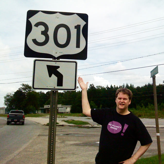 Emory Rowland standing next to a 301 sign