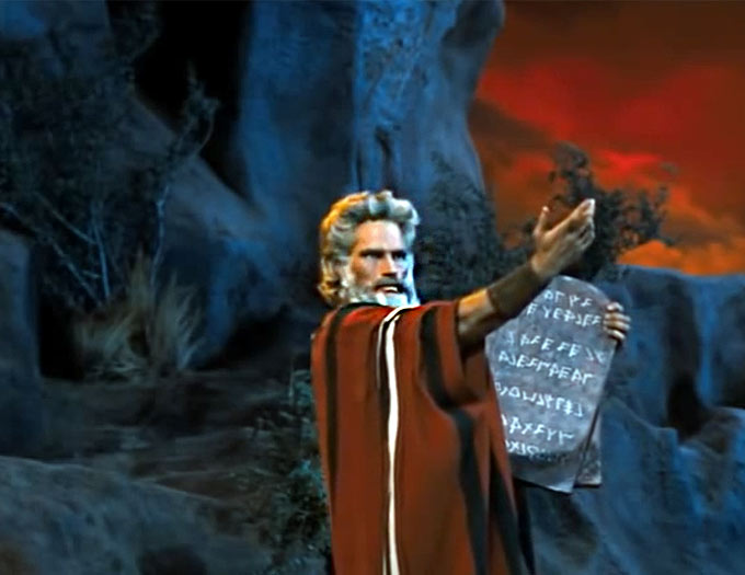Charleteon Heston as Moses holding the 10 Commandments